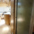 Fiberglass shower, glass shower door, and retractable clothes line