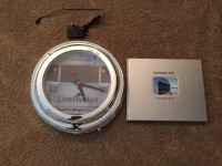 Neon Airstream Clock and Wanderlust Coffee Table Book