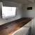 custom made reclaimed wood dining/desk, lrg window