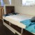 twin bed with pop-up table and storage underneath
