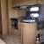 Kitchen with microwave, 3 burner stove, round sink and great storage
